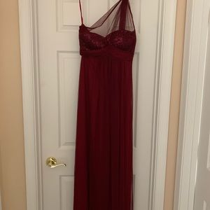 One shoulder burgundy gown with sequined cups